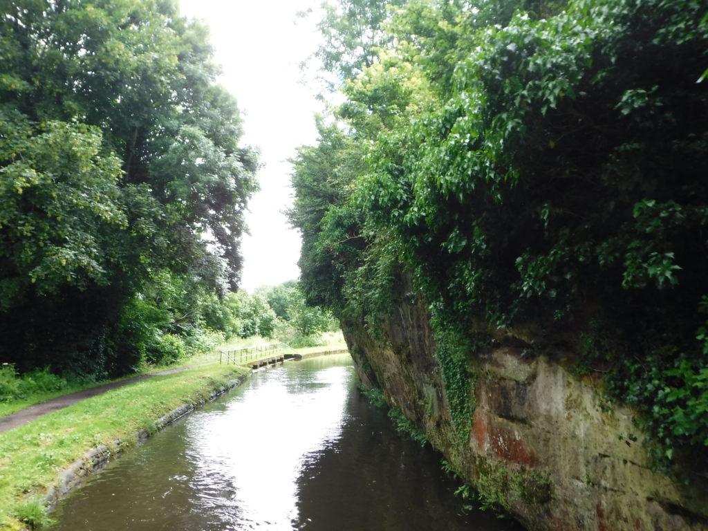 Sandstone overhanging canal